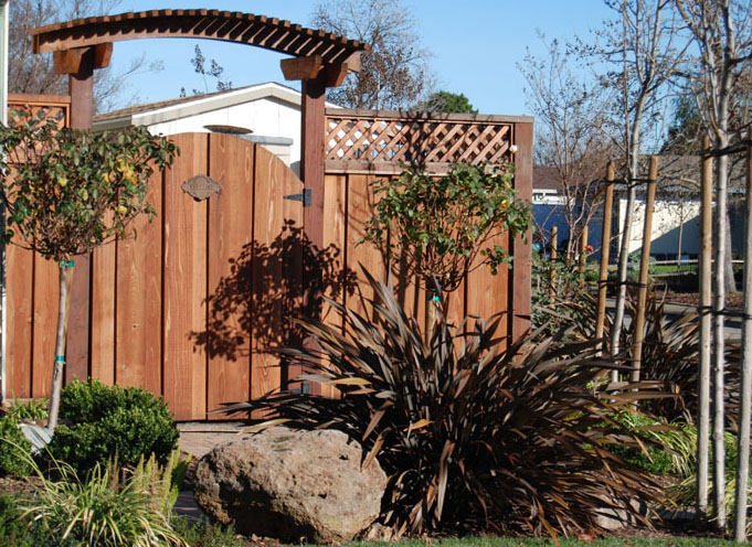 gate and fence with landscaping